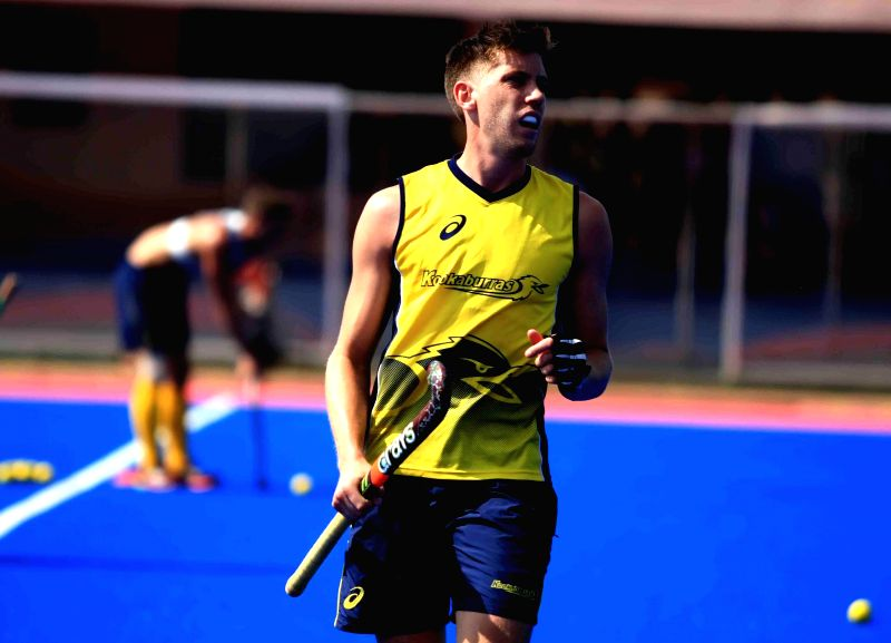 Members of Australian Hockey team during a practice session at Kalinga Stadium in Bhubaneswar, on Dec 1, 2014. (Photo : IANS)