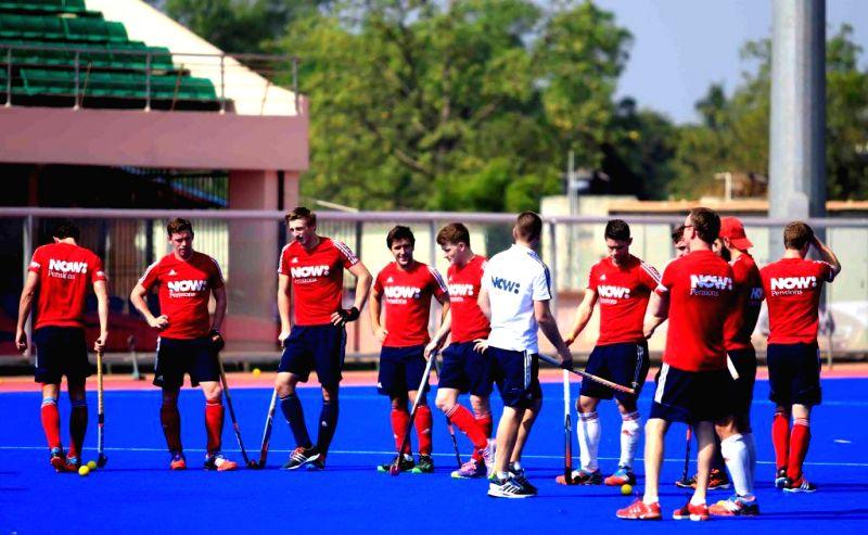 Members of British Hockey team during a practice session at Kalinga Stadium in Bhubaneswar, on Dec 2, 2014. (Photo : IANS)