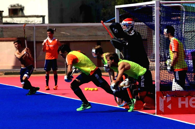 Members of Netherland Hockey team during a practice session at Kalinga Stadium in Bhubaneswar, on Dec 2, 2014. (Photo : IANS)