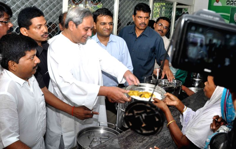 Odisha Chief Minister Naveen Patnaik distributes food at the launch of 'Aahar' - a scheme to provide subsidised food to the urban poor in five cities of the state namely Bhubaneswar, ... - Naveen Patnaik