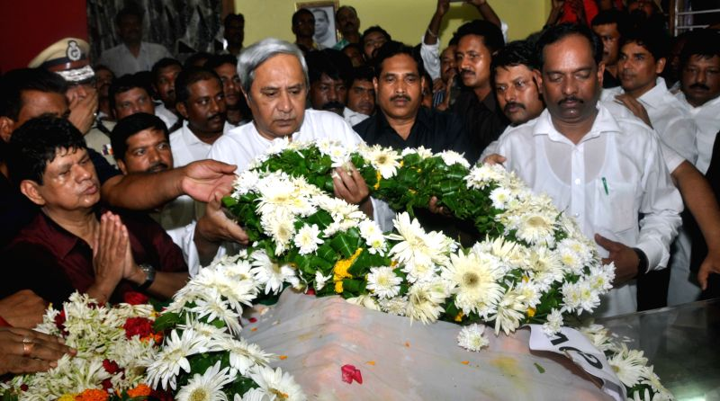 Odisha Chief Minister Naveen Patnaik pays floral tribute to three-time Odisha chief minister and former Assam governor Janaki Ballabh Patnaik who died at the age of 89 at a hospital in ...