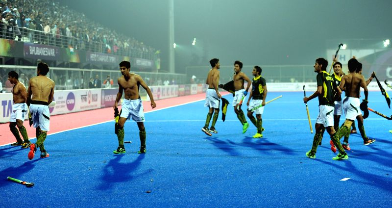 Pakistani hockey players celebrate after winning the match against India at the semifinal of the Champions Trophy at Kalinga Stadium in Bhubaneswar on Dec 13, 2014. Pakistan won. Score: .