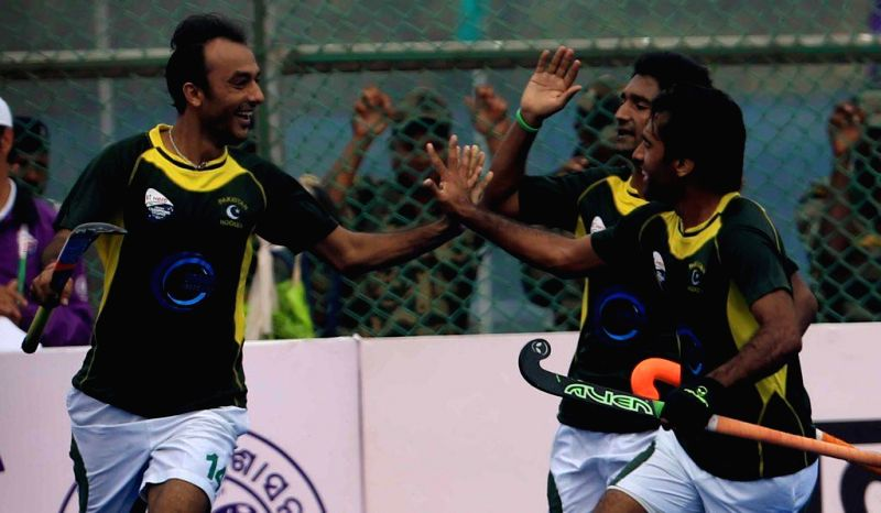 Pakistani players celebrate after scoring a goal against Netherlands during a HHCT - 2014 (Hero Hockey Men`s Champions Trophy 2014) match at Kalinga Stadium in Bhubaneswar on Dec 11, ...