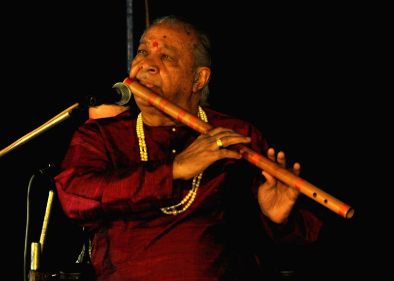 Pandit Hariprasad Chaurasia performs during a concert organised in Bhubaneswar on Dec 22, 2014.