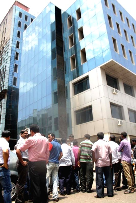 People rush out of their offices as tremors were felt in Bhubaneswar on April 25, 2015. According to the India Meteorological Department, the depth of earthquake was 10 km and measured 6 ...