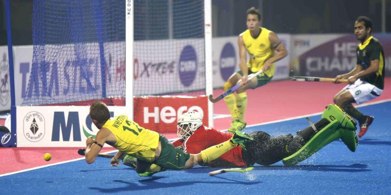 Players in action during a Hero Men`s Champions Trophy 2014 match between Australia and Pakistan at Kalinga Stadium in Bhubaneswar on Dec 9, 2014. Australia won. Score: 3-0