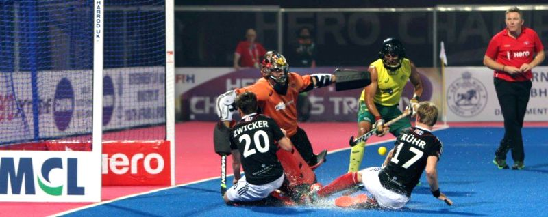 Players in action during a HHCT - 2014 (Hero Hockey Men`s Champions Trophy 2014) match between Germany and Australia at Kalinga Stadium in Bhubaneswar on Dec 13, 2014. Germany won. ...