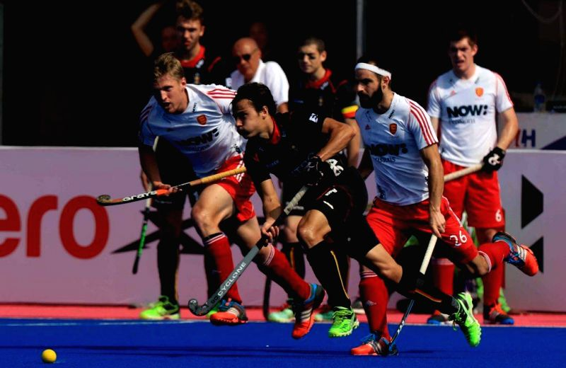 Players in action during a HHCT - 2014 (Hero Hockey Men`s Champions Trophy 2014) match between England and Belgium at Kalinga Stadium in Bhubaneswar on Dec 14, 2014.
