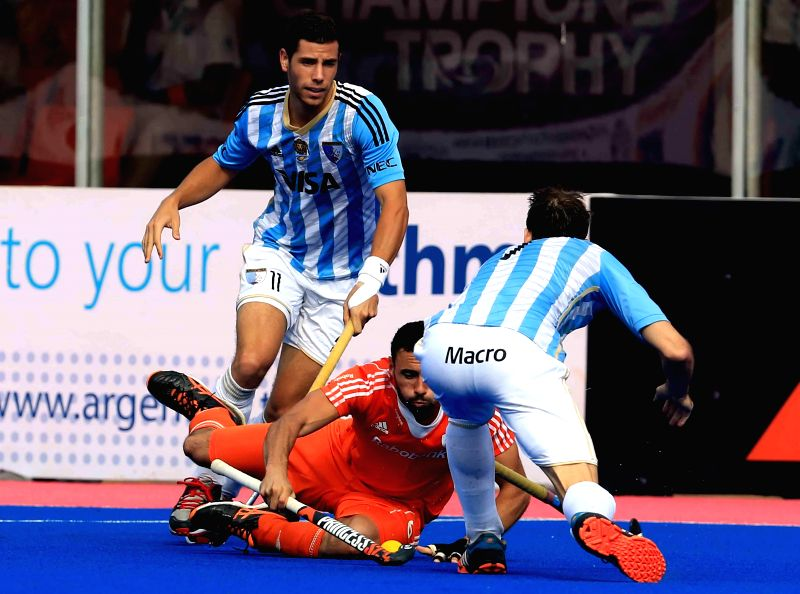 Players in action during a HHCT - 2014 (Hero Hockey Men`s Champions Trophy 2014) match between Argentina and Netherlands at Kalinga Stadium in Bhubaneswar on Dec 13, 2014.
