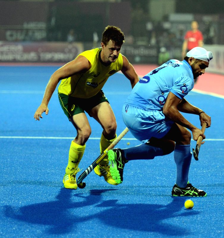 Players in action during a HHCT - 2014 (Hero Hockey Men`s Champions Trophy 2014) match between India and Australia at Kalinga Stadium in Bhubaneswar on Dec 14, 2014.