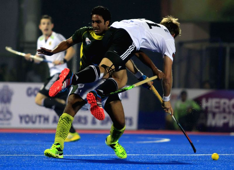 Players in action during a HHCT - 2014 (Hero Hockey Men`s Champions Trophy 2014) match between Germany and Pakistan at Kalinga Stadium in Bhubaneswar on Dec 14, 2014.