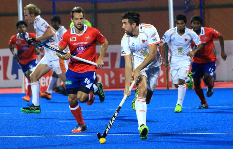 Players in action during a Hockey India League match between Kalinga Lancers and Dabang Mumbai in Bhubaneswar, on Feb 11, 2015.
