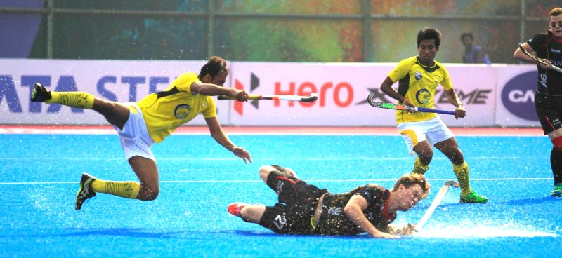 Players in action during a Pool A match between Belgium and Pakistan of Hero Men`s Champions Trophy 2014 at Kalinga Stadium in Bhubaneswar on Dec 6, 2014. Belgium was leading 2-1 against
