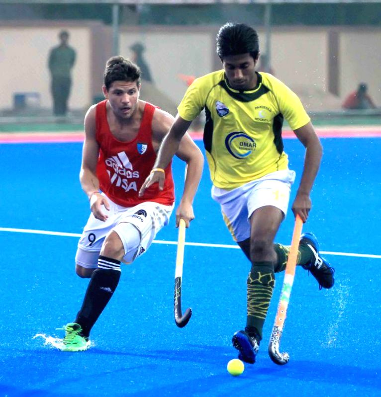 Players in action during a practice match between Pakistan and Argentina during Hero Men's Champions Trophy 2014 at Kalinga Stadium in Bhubaneswar on Dec 3, 2014.