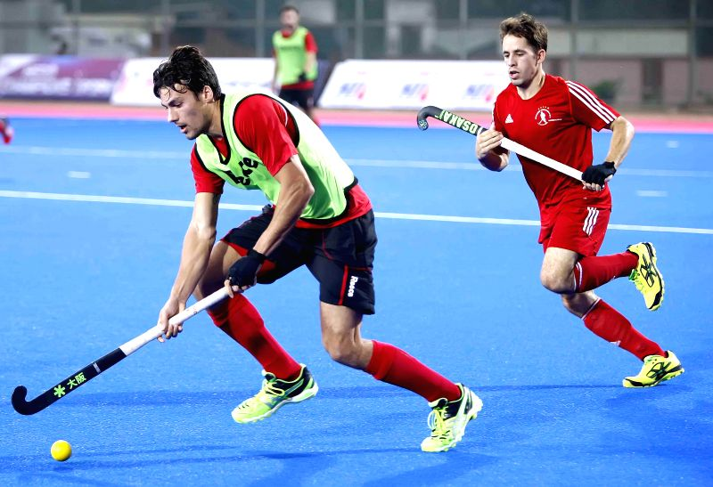 Players in action during a practice match of Hero Men's Champions Trophy 2014 between Belgium and Germany at Kalinga Stadium in Bhubaneswar on Dec 4, 2014. Belgium won.