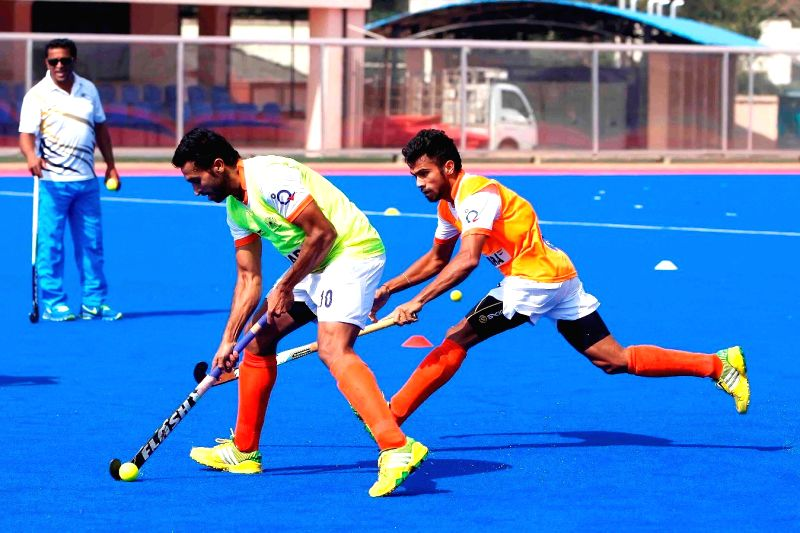 Players of Indian men's hockey team during a practice session in Bhubaneswar, on Nov 28, 2014. (Photo : IANS)
