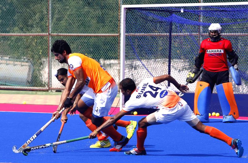 Players of Indian men`s hockey team during a practice session for upcoming Hero Men`s Champions Trophy 2014, at the Kalinga Stadium, Bhubaneswar on Nov. 29, 2014.