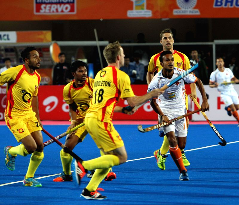 Players of Kalinga Lancers and Ranchi Rays in action during the opening match of Hockey India League in Bhubaneswar, on Jan 22, 2015. (Photo : IANS)
