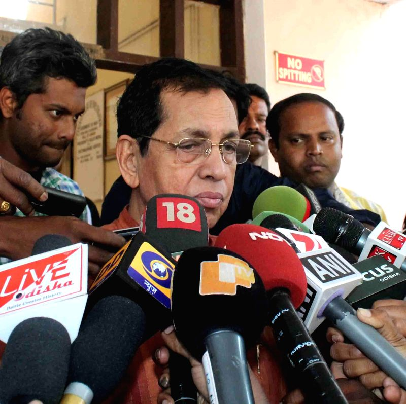 Rajya Sabha MP Pyarimohan Mohapatra arrives to appear before CBI in connection with a with the multi-crore rupees chit fund scam in Bhubaneswar, on Nov 21, 2014. (Photo : Arabinda ...