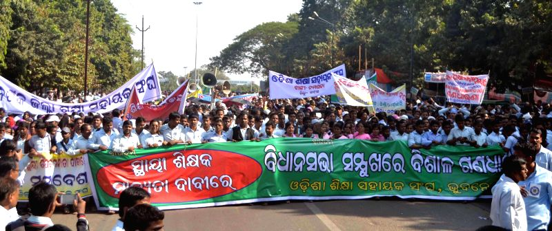 Teachers stage a demonstration in front of Odisha Assembly to demand regularisation of their jobs in Bhubaneswar, on Dec 2, 2014. (Photo : Arabinda Mahapatra/IANS)