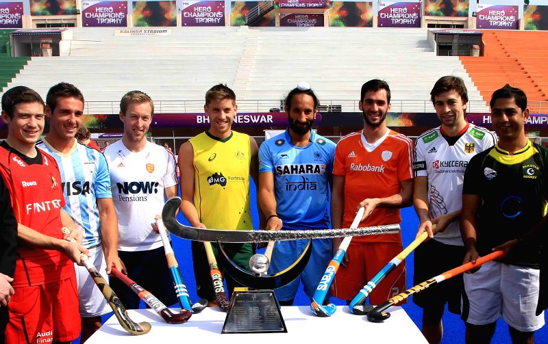 The captains of Hockey teams from different nations including Indian captain Sardar Singh, pose for a photograph during a programme organised to unveil the trophy of Hero Men`s Champions - Sardar Singh