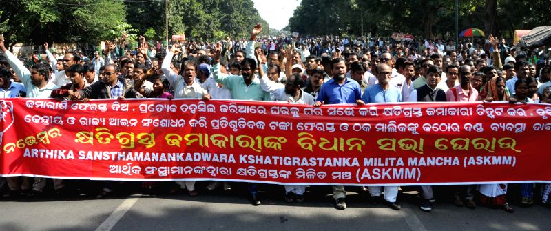 Thousands of depositors duped by chit fund companies hold demonstration in front Odisha assembly in Bhubaneswar on Nov. 20, 2014.
