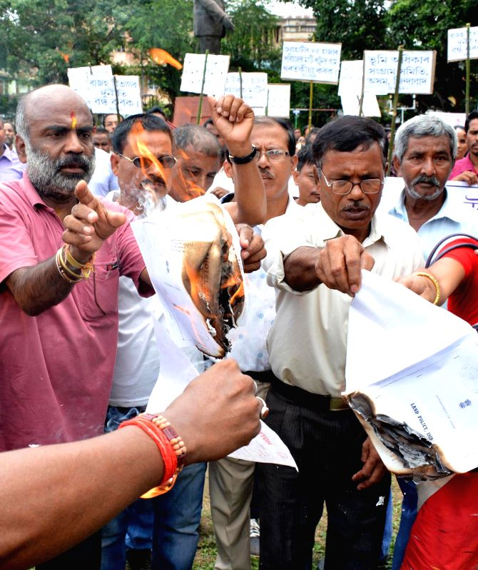 Bhumi Adhikar Sangram Samiti (BASS) activists demonstrate against administration's eviction drive in Guwahati on July 7, 2014.
