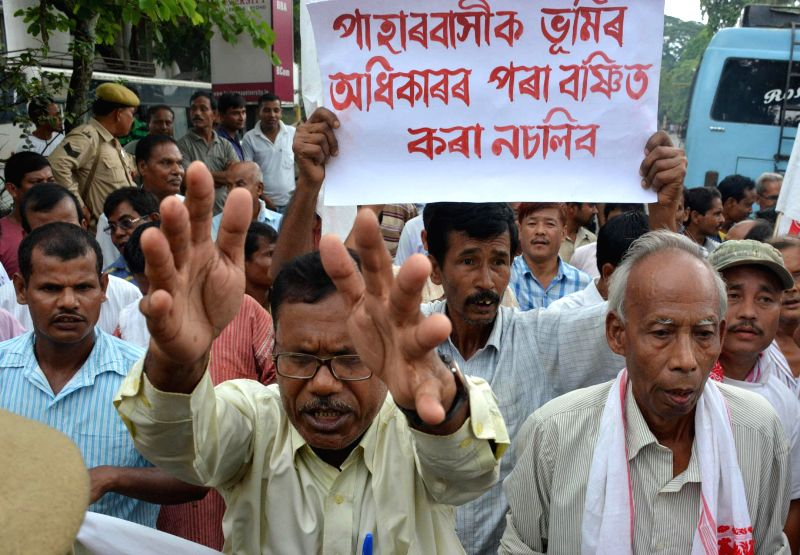 Bhumi Adhikar Sangram Samiti (BASS) activists stage a demonstration in Guwahati on Aug 12, 2014.