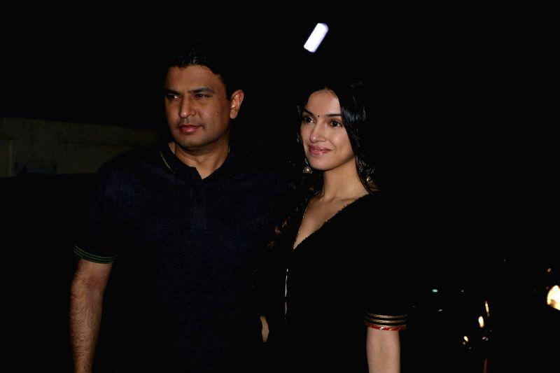 Bhushan Kumar, Managing Director of T Series and his wife during the special screening of film Badrinath Ki Dulhaniya in Mumbai on March 6, 2017. - Bhushan Kumar