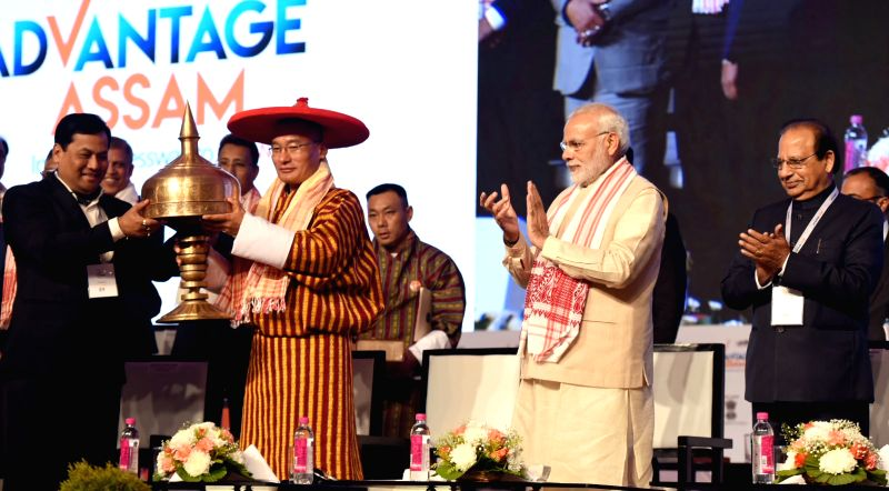 Bhutanese Prime Minister Tshering Tobgay, Prime Minister Narendra Modi and Assam Chief Minister Sarbananda Sonowal at the Advantage Assam- Global Investors Summit 2018 in Guwahati on Feb 3, ... - Tshering Tobgay and Narendra Modi