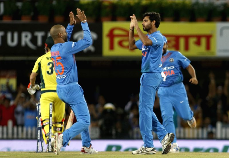 Bhuvneshwar Kumar of India celebrates fall of David Warner's wicket during the first T20 match between India and Australia at JSCA International Stadium in Ranchi on Oct 7, 2017. - Bhuvneshwar Kumar