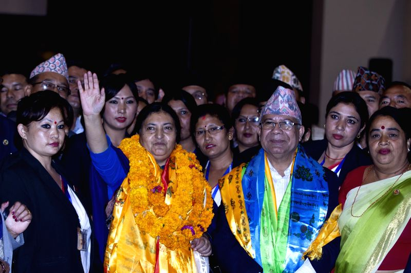 Bidhya Devi Bhandari (2nd L, front), Vice Chairperson of the Communist Party of Nepal (Unified Marxist-Leninist), gestures after winning the election at the ...