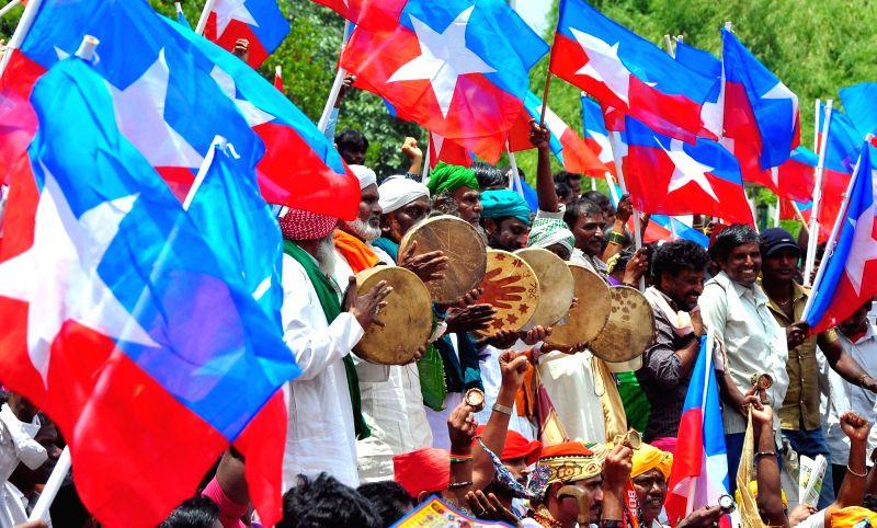 Bidugadeta Chirutegalu Karnataka members stage a demonstration  stage a demonstration to press for their various demands in Bengaluru on July 18, 2016.
