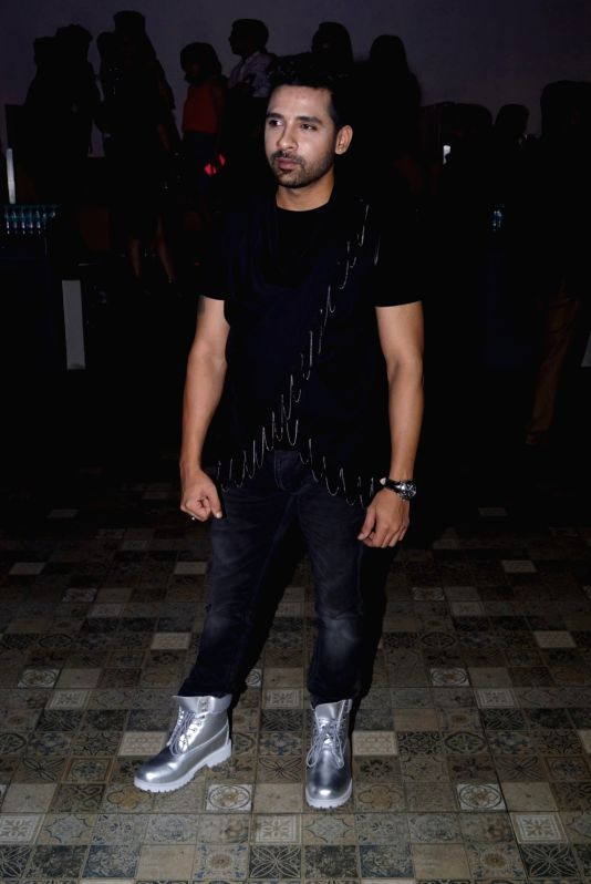 """Bigg Boss 11 contestant Puneesh Sharma at the launch of music composer-singer duo Manmeet Singh and Harmeet song """"Love Me"""" in Mumbai on Aug 6, 2018. - Puneesh Sharma and Manmeet Singh"""