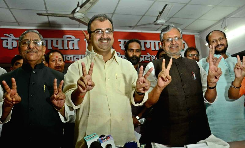 Bihar BJP chief Mangal Pandey and BJP leader Sushil Kumar Modi during a programme to celebrate their victory at the resent Bihar Legislative Council polls in Patna on July 10, 2015. - Mangal Pandey and Sushil Kumar Modi