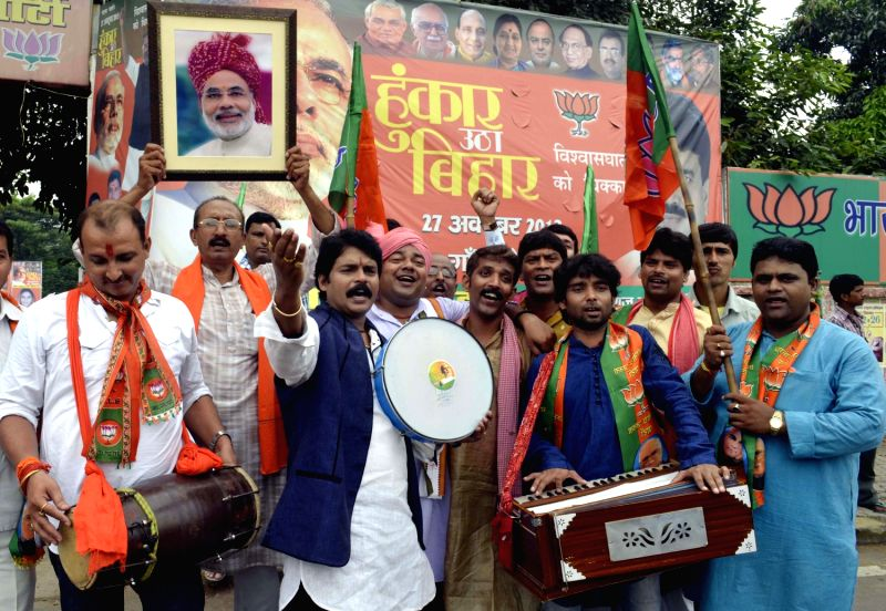 Bihar BJP workers advertise `Hunkar Rally` in Patna on Oct. 3, 2013. BJP Prime Ministerial candidate and Gujarat Chief Minister Narendra Modi will be addressing Hunkar Rally scheduled to be held on .. - Narendra Modi