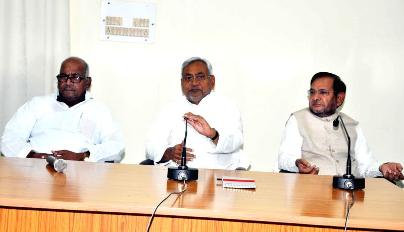 Bihar Chief Minister and JD-U leader Nitish Kumar with party chief Sharad Yadav during legislative party meeting in Patna on May 18, 2014. - Nitish Kumar and Sharad Yadav