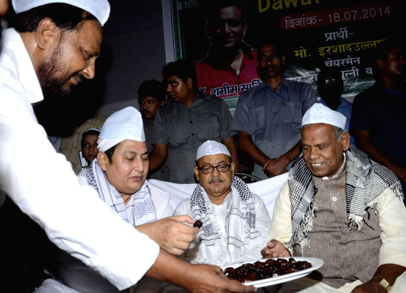 Bihar Chief Minister Jitan Ram Majhi during an `Iftar` party at Anjuman Islamia in Patna on July 18, 2014. - Jitan Ram Majhi