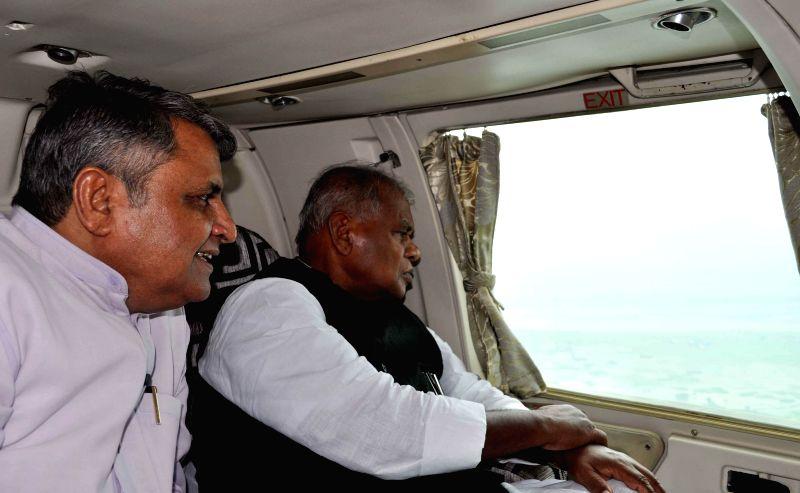 Bihar Chief Minister Jitan Ram Majhi during an aerial inspection of flood hit Supaul, Saharsa and Madhepura district of Bihar on Aug 22, 2014.