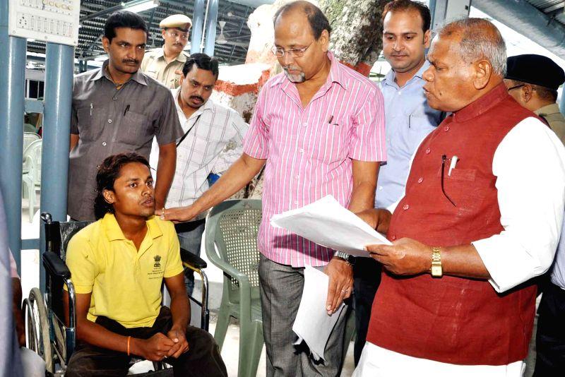 Bihar Chief Minister Jitan Ram Majhi  goes through a letter addressed to him by public at Janta Durbar in Patna on Sept 1, 2014. - Jitan Ram Majhi
