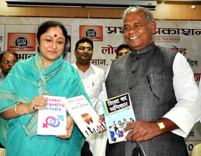Bihar Chief Minister Jitan Ram Majhi launches a book on former Bihar Chief Minister Karpoori Thakur in Patna on Aug 21, 2014. - Jitan Ram Majhi