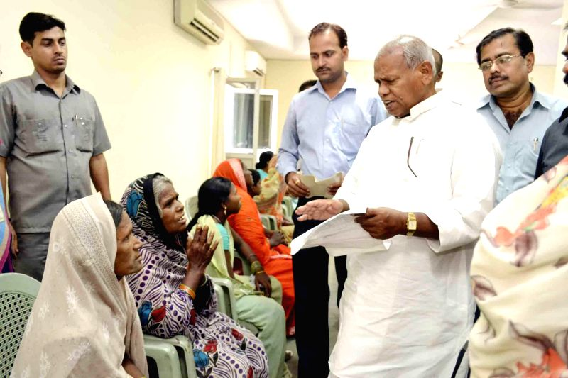 Bihar Chief Minister Jitan Ram Majhi listens to public grievances during Janata Durbar in Patna on June 18, 2014. - Jitan Ram Majhi