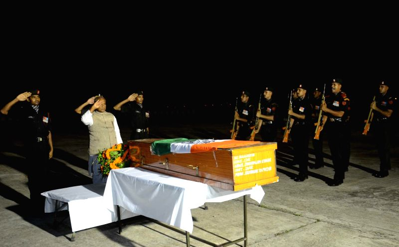 Bihar Chief Minister Jitan Ram Majhi pays tribute to the mortal remains of soldier Dhananjay Kumar who made supreme sacrifice for the nation during cross border firing in Jammu and Kashmir in Patna .. - Jitan Ram Majhi