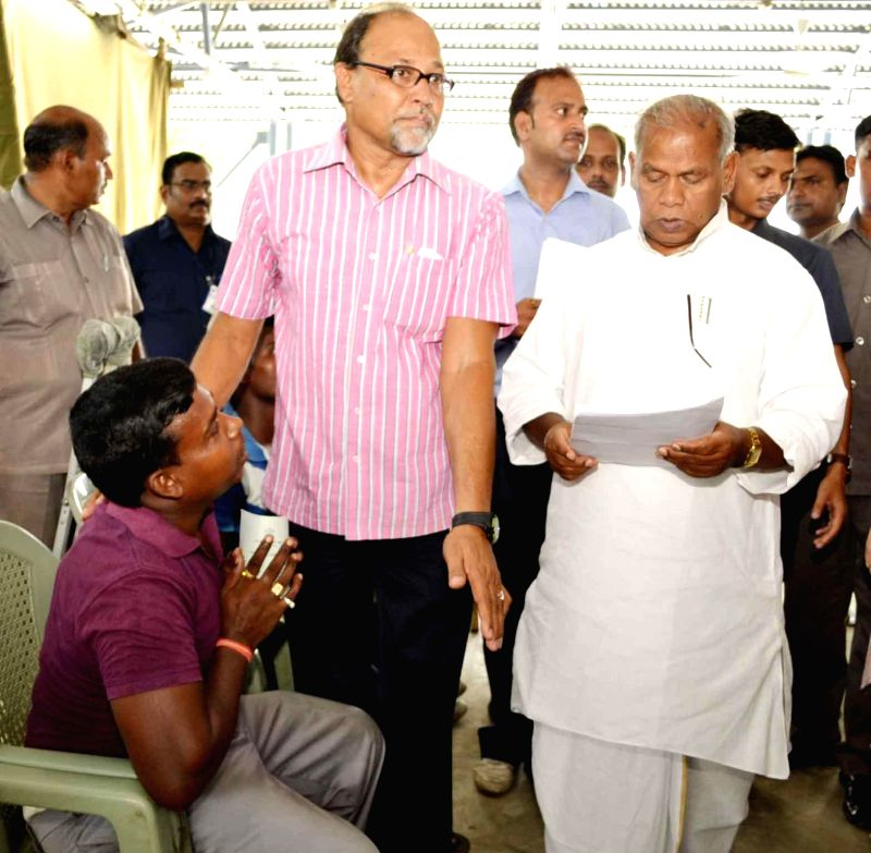 Bihar Chief Minister Jitan Ram Manjhi meeting people during a janta darbar in Patna on June 16, 2014.