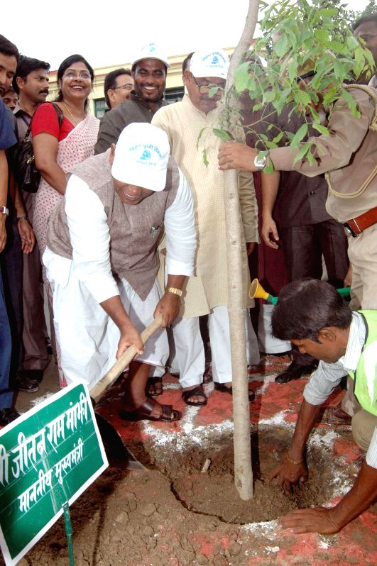 Bihar Chief Minister Jitan Ram Manjhi plant saplings during an event organised by the department of environment and forests on the ``Bihar Prithvi Diwas`` in Patna on Aug. 9, 2014.