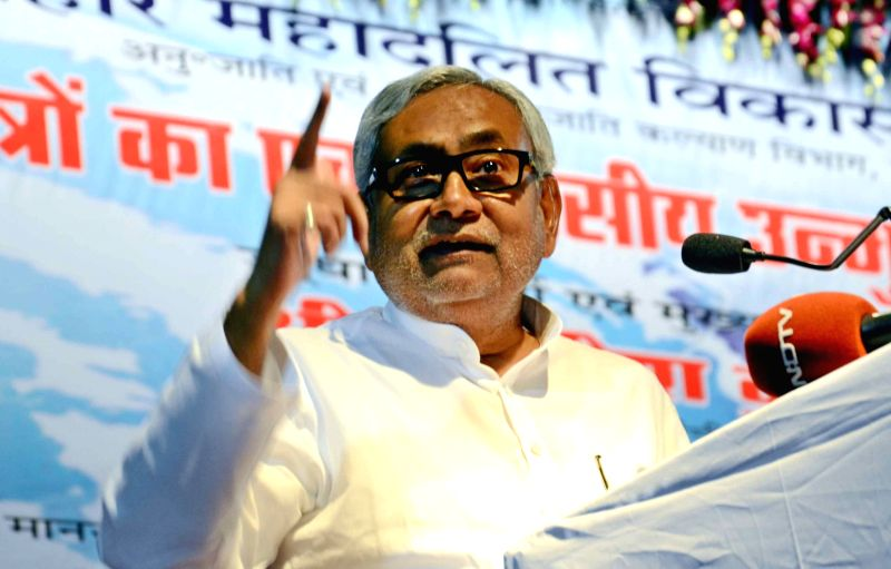 Bihar Chief minister Nitish Kumar addresses during a one day workshop on `Vikas Mitra` in Patna on July 11, 2015. - Nitish Kumar