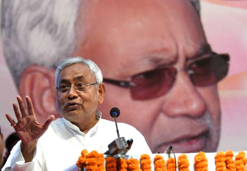 Bihar Chief Minister Nitish Kumar addresses during a programme organised on martyrs day of Veer Kunwar Singh in Patna on April 26, 2017. - Nitish Kumar and Kunwar Singh