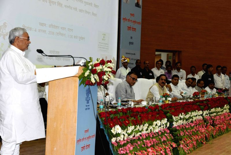 Bihar Chief Minister Nitish Kumar addresses during a programme on SC/ST welfare schemes in Patna on Aug 4, 2018. - Nitish Kumar