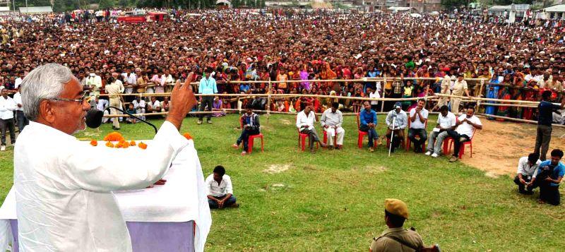 Bihar Chief Minister Nitish Kumar addresses a rally in Triveniganj of Bihar on Oct 30, 2015.
