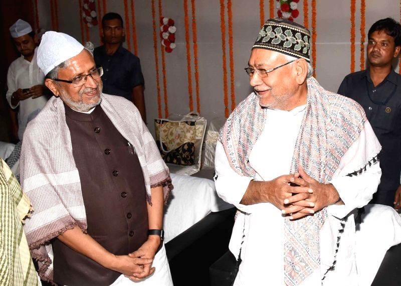 Bihar Chief Minister Nitish Kumar and Bihar Deputy Chief Minister Sushil Kumar Modi during an iftaar party at Haj Bhavan in Patna, on June 13, 2018. - Nitish Kumar and Sushil Kumar Modi